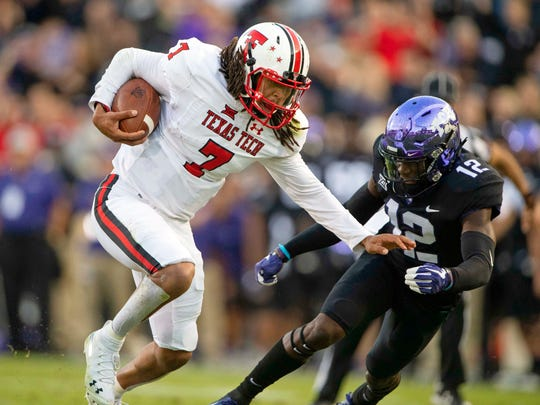 Oct 11, 2018; Fort Worth, TX; Texas Tech Red Raiders quarterback Jett Duffey (7) tries to elude TCU Horned Frogs cornerback Jeff Gladney (12) during a game at Amon G. Carter Stadium. Photo Credit: Jerome Miron - USA TODAY Sports