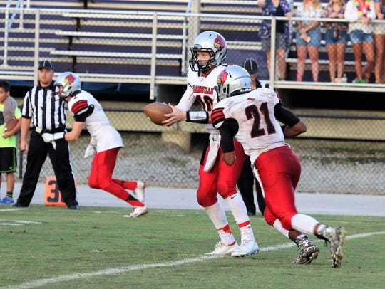 Adamsville's Colin Misenhiemer (10) hands the ball