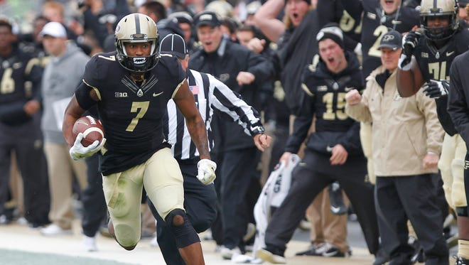 The Purdue bench explodes as DeAngelo Yancey heads for the endzone on a 82-yard touchdown reception against Nebraska Saturday, October 31, 2015, at Ross-Ade Stadium. Purdue beat Nebraska 55-45.