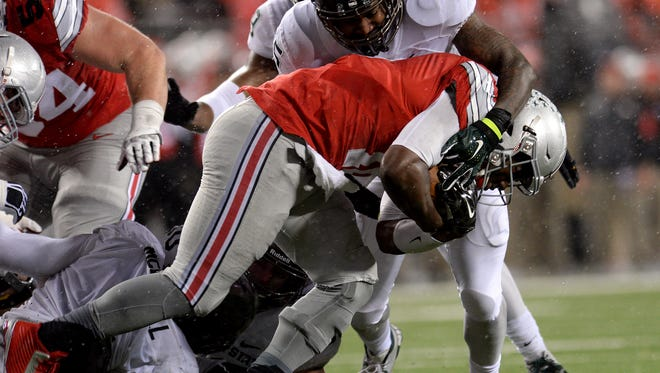 Linebacker Darien Harris tackles OSU quarterback J.T. Barrett in the third quarter of the Spartans 17-14 victory Saturday November 21, 2015, at Ohio Stadium in Columbus, Ohio.