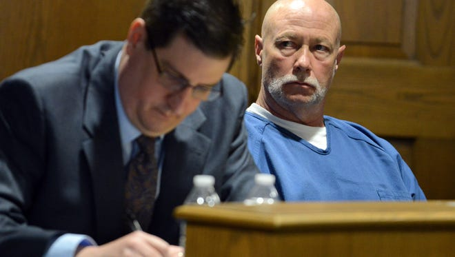 Jeffrey Scott Hamm, right, listens as Fairfield County Prosecutor Gregg Marx (not pictured) speaks during a suppression hearing for Hamm's murder trial. Hamm's attorney Andrew Stevenson, left, takes notes.