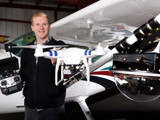 James Aarestad, Eagle Eye Photos, with his plane and drone he uses for shooting ariel photos Wednesday at the Buffalo Municipal Airport. Aarestad has received an exemption from the Federal Aviation Administration to use his unmanned aerial vehicles, or UAV for business purposes.