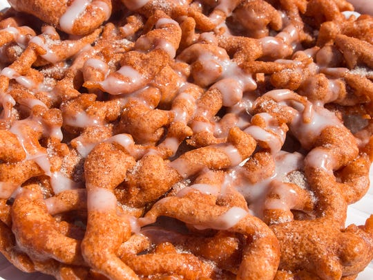 Funnel cake topped with icing from Savory's Pumpkin Funnel Cakes at the York Fair Monday September 12 2016