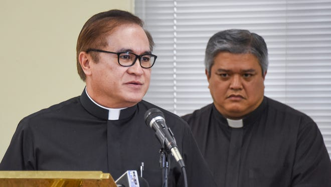 Monsignor James Benavente, left, responds to a question during a press conference, as Archdiocese of Agana Delegate to the Apostolic Administrator Father Jeff San Nicolas looks on, at the Dulce Nombre de Maria Cathedral-Basilica in Hagåtña on Monday, Oct. 3, 2016. San Nicolas announced, that as of Oct. 1, Benavente has been appointed to serve as Delegate of the Apostolic Administrator for Church Patrimony.