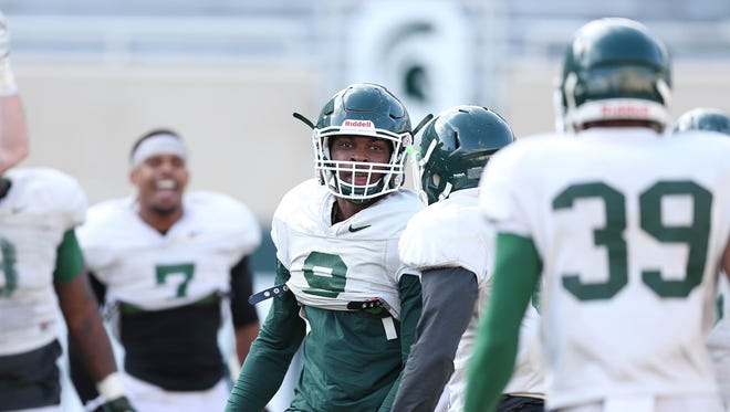 Michigan State safety Montae Nicholson celebrates one of his two interception returns for touchdowns during Friday's scrimmage.