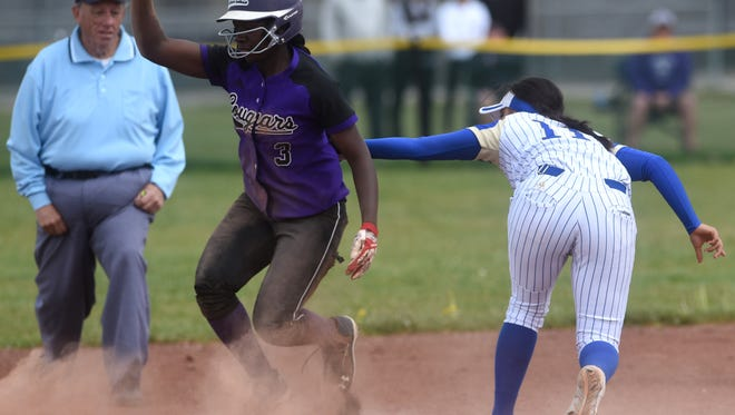 Spanish Springs' Amidori Anderson (3) slides safely into second base past the tag by Reed's Carla Hernandez during their softball game in Sparks on May 6, 2017.