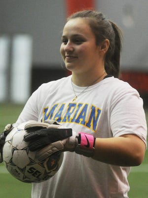 Megan Bricely wears a smile of pride, knowing her hard work is paying off with a chance to play women's soccer at Albion College.