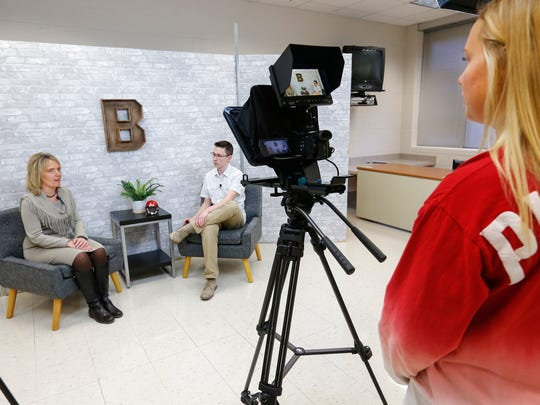 Margie Vandeven, commissioner of education for Missouri, talks with Branson High School junior Alex Brown as senior Tori O'Dell films them on Friday, January 27, 2017.