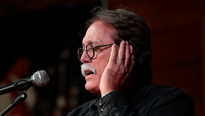 """Barry Ancelet performs a song from the """"Broken Promised Land"""" CD during the Gateway to the Grammys benefit concert at Vermilionville."""