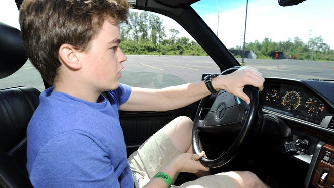 Nick Manting, 17, of Lake Orion, navigates the slalom course while driving a 1993 Mercedes Benz 500E.
