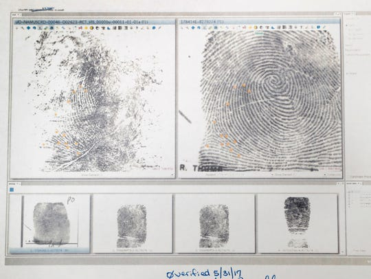 Fingerprints for John Downey are displayed Wednesday,
