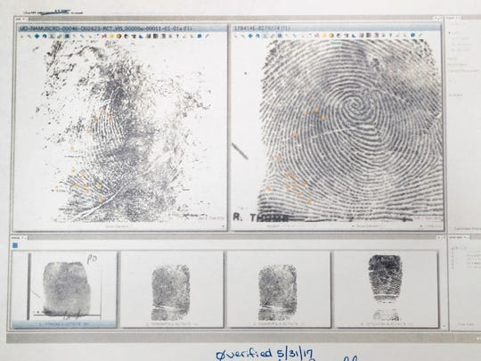 Fingerprints for John Downey are displayed Wednesday, Aug. 30, 2017, in the Polk County Medical Examiner's office in Des Moines, Iowa. The fingerprint taken from Downey's severely decomposed body, found in February of 1984, at left, was matched to a print on file, right, when FBI began using new technology to resolve identity cases dating back to the 1970s.