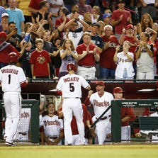 Manager Kirk Gibson cheers after rizona Diamondbacks Ender Inciarte hit a three-run home run to right field against the Pittsburgh Pirates on Friday, Aug. 1, 2014 at Chase field in Phoenix.