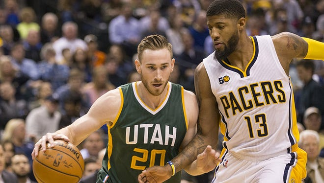 Gordon Hayward (left), of Utah, works around Paul George of Indiana, first half, Utah Jazz at Indiana Pacers, Bankers Life Fieldhouse, Indianapolis, Monday, March 20, 2017.