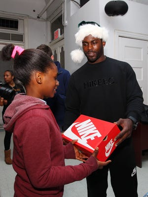 New York Jets quarterback Michael Vick donates Nike footwear to children at the Boys and Girls Club of Harlem.