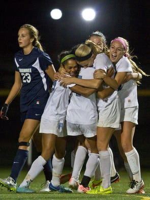 Freehold celebrates a goal by Nicole Whitney, center,