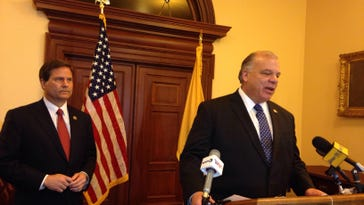 Rep. Donald Norcross, left, and state Senate President Stephen Sweeney discuss proposals to raise the minimum wage to $15 an hour at a Statehouse news conference on Tuesday, February 9, 2016. Sweeney called for a constitutional amendment on the 2017 ballot. (Michael Symons/Asbury Park Press)
