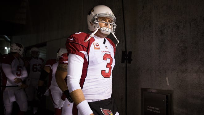 Arizona Cardinals quarterback Carson Palmer (3) leads his team out of the tunnel for warm ups against the Philadelphia Eagles at Lincoln Financial Field.