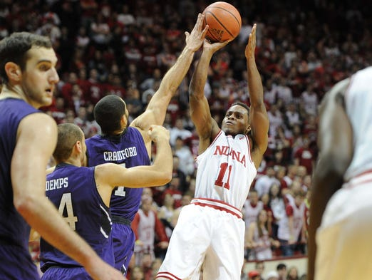 Yogi Ferrell has a shot blocked by Drew Crawford in the lane during the second half. I. U. hosted Northwestern in Big Ten basketball action Saturday January 18, 2014 at Assembly Hall. Northwestern won 54-47.