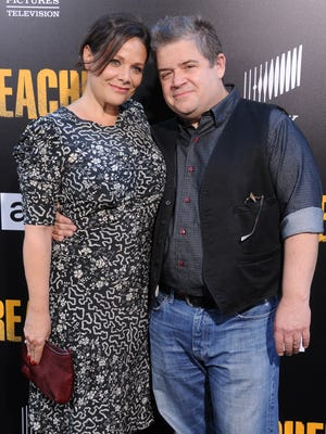Patton Oswalt and Meredith Salenger, posing here at the Season 2 premiere of AMC's 'Preacher,' have tied the knot.