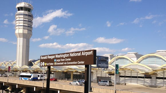"This file photo from April 13, 2013, shows the control tower as seen from the ""Metro"" subway platform at Washington's Reagan National Airport."