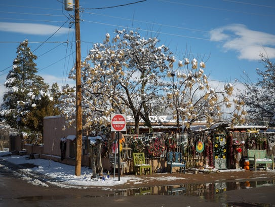 A light coating of snow dusts a street corner in Mesilla