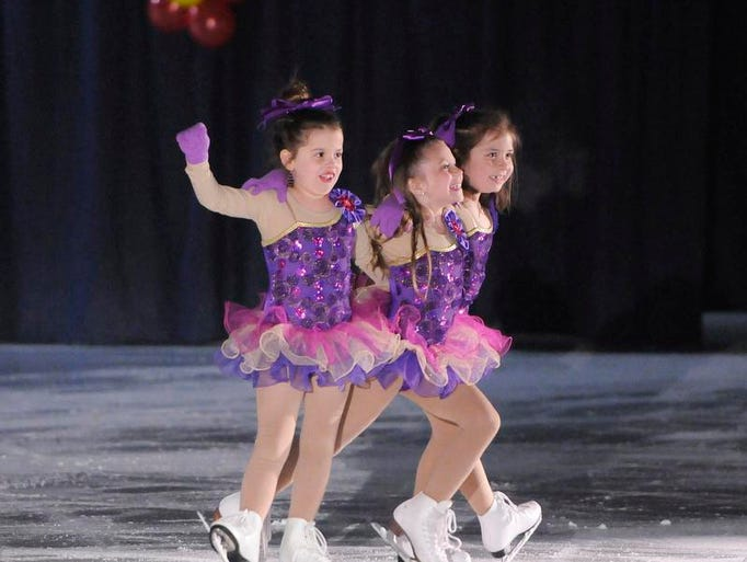 "Skaters perform to ""Celebration"" during Friday's River Lakes Figure Skating Club Ice Show in Richmond."