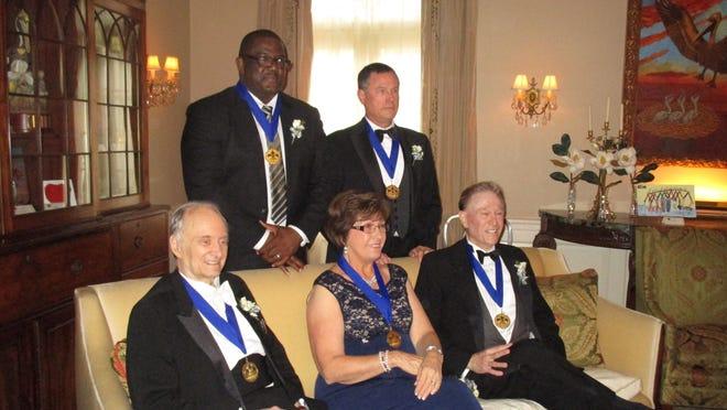 Louisiana Legends Joe Dumars, Robert Crais, (standing) and Rolland Golden, Kathleen Blanco and Roger Ogden (seated).