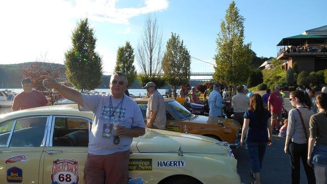 "Tom Nawojczyk standing next to his 1966 Jaguar during last year's ""Hemmings Motor News"" Great Race from Maine to Florida. This year's race runs from Missouri to the Santa Monica Pier, passing through cities like San Bernardino and Twentynine Palms."