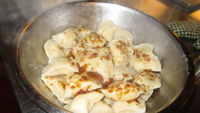 A bowl of freshly-made pierogies drizzled with browned onions and butter is shown, from the kitchen of the Ukrainian American Cultural Center of NJ in Whippany. Volunteers at the center will prepare 12,000 homemade pierogies in time for the Ukrainian Festival on Saturday, Oct. 3.