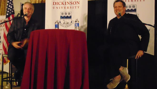 """Wesley Stace, left, and Isaac Mizrahi take questions from the audience during """"A Conversation with Isaac Mizrahi"""" at Fairleigh Dickinson University's WAMfest on Friday, Oct. 16, 2015."""