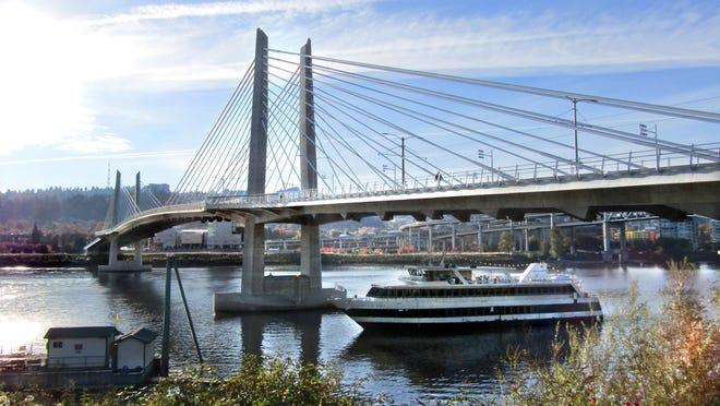 Portland Spirit cruise ship goes under Portland Tilikum Crossing, Portland's newest bridge that bans automobiles.