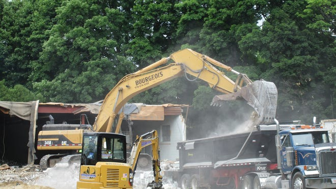 Debris from the demolition of the former E.F. Dodge Paper Box Company property (later the Gariepy Furniture warehouse) at 116-124 Central St. is loaded onto a truck on Wednesday, June 24.