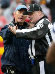 San Diego Chargers head coach Mike McCoy, left, argues a call with head linesman Ed Camp during the first half of an NFL football game against the Kansas City Chiefs in Kansas City, Mo., Sunday, Dec. 13, 2015. (AP Photo/Charlie Riedel)