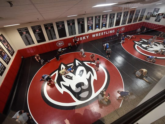 New mats line the floor of the St. Cloud State wrestling