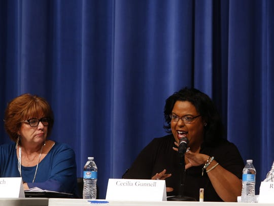 City Council candidate Cecilia Gunnell, center, answers a question Tuesday during a candidate forum at Bloomfield High School. Council candidates Sue Finch and Richard Kemp listen to her answer.