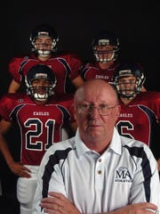 Montgomery Academy's Thomas Tyson, back, left, Josh Hunter, Anthony McCall, front, left, and Harris Brown back up their head football coach, John Tatum. (Montgomery Advertiser, Karen S. Doerr) High School Prep Tab Cover