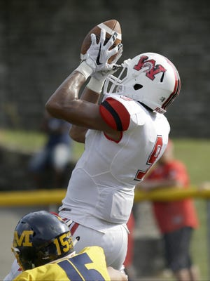 Wayne's L'Christian Smith catches a touchdown pass during the Warriors 22-24 win over Moeller. (Photo by Tony Tribble)