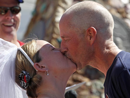 Heidi Hurst and Pete Parker kiss at their wedding ceremony during the Reno-Tahoe Odyssey at exchange 30 in Virginia City Saturday. Parker ran leg 30 and after the ceremony Hurst continued onto leg 31.