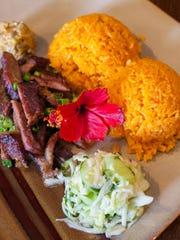 The tina'la' katne plate is served with smoked beef,