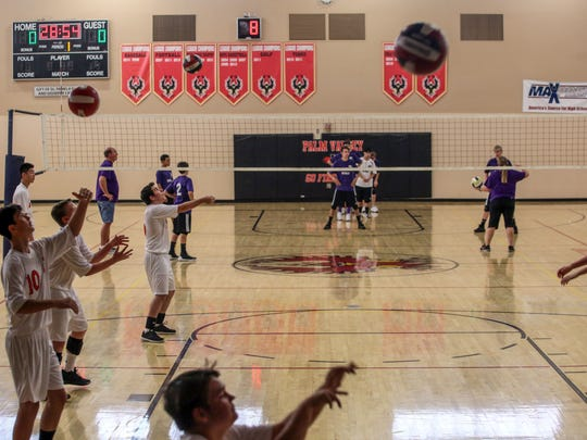 Members of the Palm Valley High School boys volleyball team warmup for their first game against Victor Valley Christian on Tuesday, September 5, 2017 in Rancho Mirage.