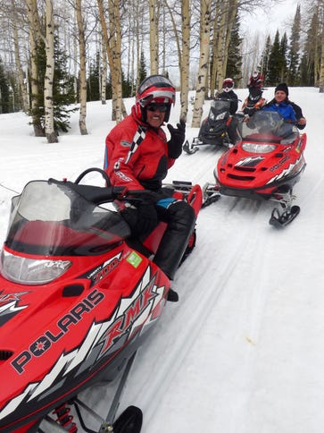 Richard Petty (left) on a snowmobiling trip in the