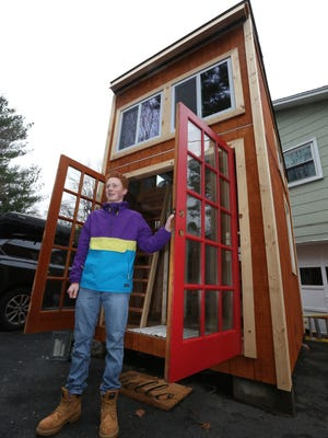 Matthew Olson at his Chestnut Ridge home with the tiny house he is building for his Green Meadow Waldorf School senior project April 7, 2017.