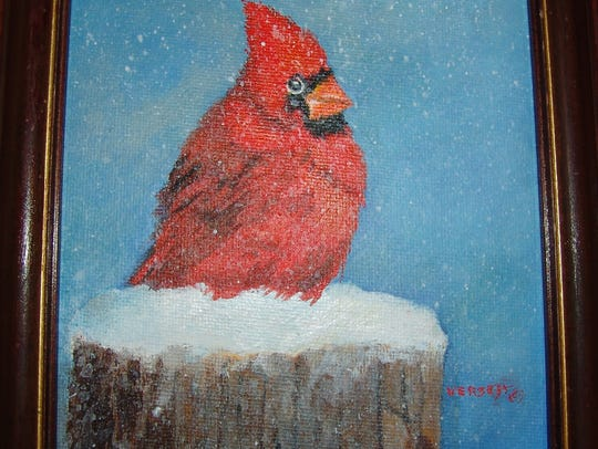 A painting by Versch of a cardinal, inspired by birds