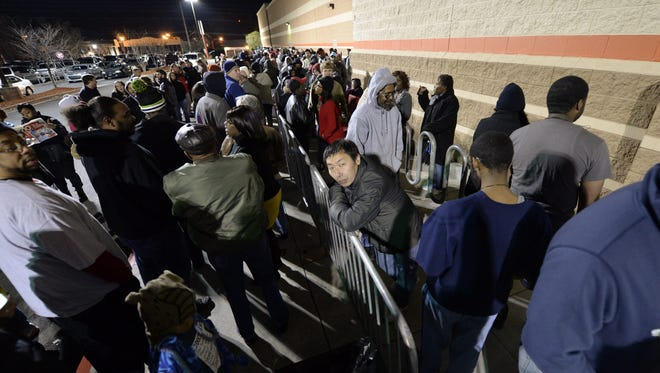 People wait in line to be the first to enter and shop at a Target store in Atlanta Thursday.