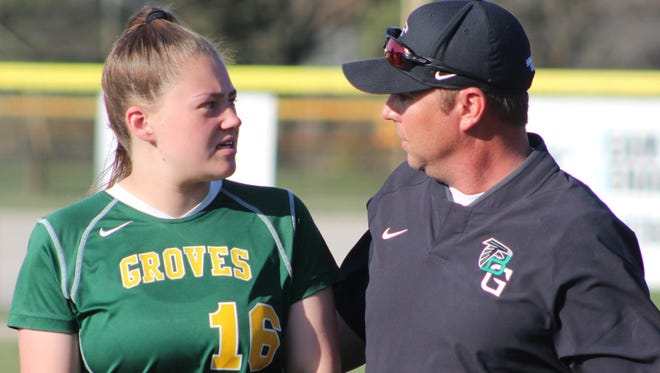 Second-year head coach Brian Baldridge offers a few words of advice to Groves sophomore Jenna Ringler.