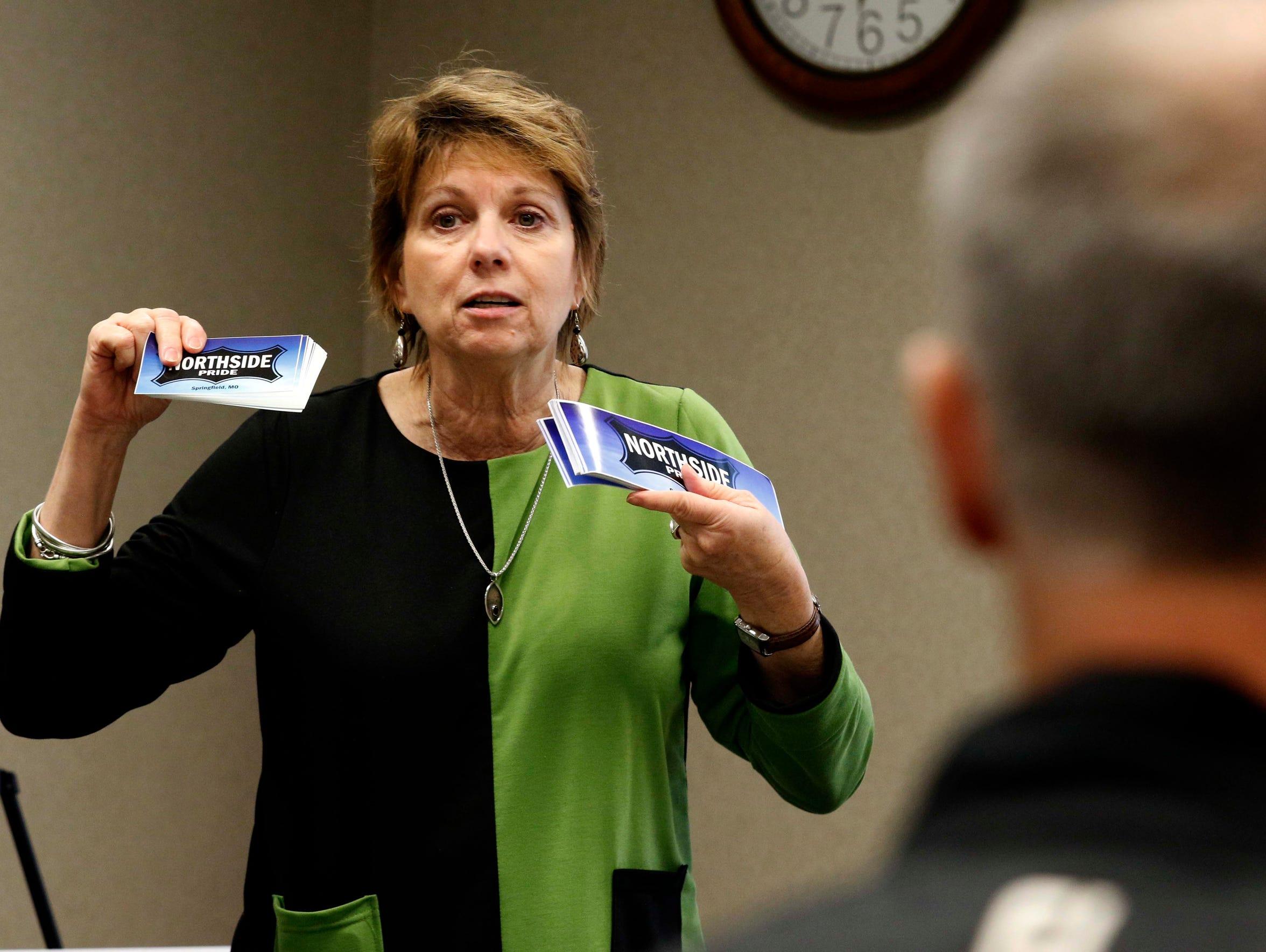 "Zone 1 representative Phyllis Ferguson hands out ""Northside"
