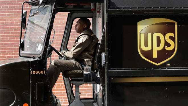 A UPS driver takes his truck on a delivery route, in New York.