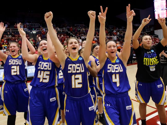 South Dakota State players celebrate after a 74-71