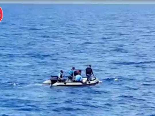 This still image taken from video posted Saturday, May 21, 2016, on the official Facebook page of the Egyptian Armed Forces spokesman shows an Egyptian dinghy collecting wreckage of EgyptAir flight 804.